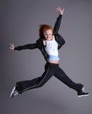 La donna che salta e che balla Immagini Stock