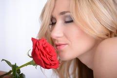 La donna con è aumentato Fotografie Stock