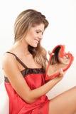 La donna con colore rosso è aumentato Fotografie Stock