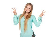 La donna con i pollici aumenta il gesto Immagine Stock