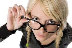 La donna con i vetri assomiglia come a ragazza nerdy, umore Immagini Stock Libere da Diritti