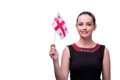 La donna con la bandiera georgiana isolata su bianco Immagine Stock