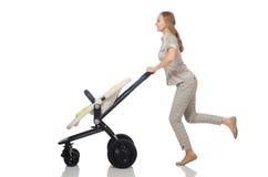 La donna con la carrozzina isolata su bianco Fotografia Stock