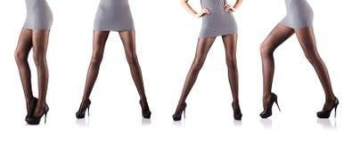 La donna con le gambe alte isolate su bianco Immagini Stock