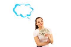 La donna con soldi sogna su fondo bianco Fotografie Stock Libere da Diritti