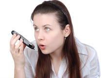 La donna con un telefono cellulare Immagine Stock Libera da Diritti