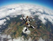 La donna costumed lo scheletro nella caduta libera Fotografie Stock