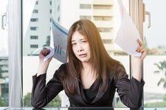 La donna di affari è sollecitata Immagine Stock