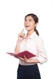 La donna di affari asiatica prende nota sul taccuino immagini stock libere da diritti
