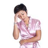 La donna di affari asiatica soffre lo sforzo Fotografia Stock