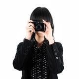 La donna di affari cattura una foto con la macchina fotografica di Digitahi Fotografie Stock Libere da Diritti