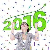 La donna di affari celebra un nuovo anno di 2016 Fotografie Stock
