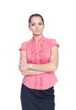 La donna di affari che si leva in piedi con le mani ha piegato i agains Fotografie Stock