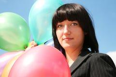 La donna di affari con gli aerostati Immagine Stock Libera da Diritti