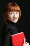 La donna di affari con il libro Fotografia Stock