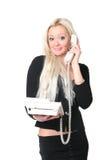 La donna di affari con il telefono fotografia stock