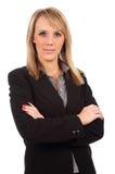 La donna di affari con le braccia ha piegato Fotografie Stock Libere da Diritti