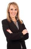 La donna di affari con le braccia ha piegato Fotografia Stock