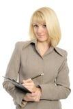 La donna di affari con una matita e un dispositivo di piegatura immagini stock