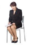 La donna di affari con una penna in mani Fotografia Stock