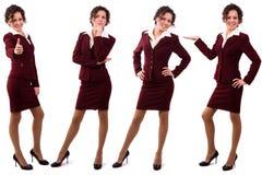 La donna di affari del Brunette si è vestita nel vestito del redk. Fotografia Stock