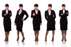 La donna di affari del Brunette si è vestita in vestito nero. Fotografia Stock