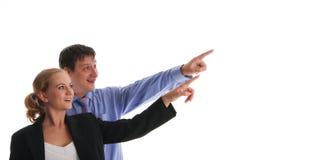 La donna di affari e l'uomo d'affari mostrano da parte immagine stock