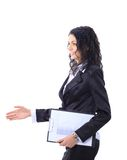 La donna di affari estende la mano fotografia stock libera da diritti