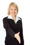 La donna di affari estende la mano Fotografie Stock Libere da Diritti