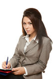 La donna di affari firma i documenti fotografia stock libera da diritti