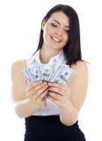 La donna di affari guarda un fan di soldi nelle mani Fotografie Stock