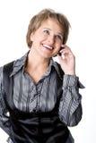 La donna di affari parla dal telefono Fotografie Stock