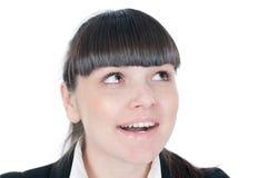 La donna di affari sta osservando su qualcosa Immagine Stock