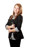 La donna di affari tiene i appunti Immagine Stock