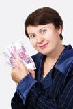 La donna di affari tiene le banconote Immagine Stock