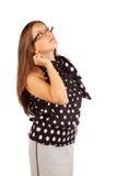 La donna di affari in vetri osserva in su Fotografia Stock