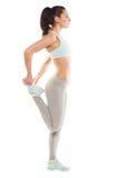La donna di forma fisica sta allungando prima di pareggiare Forma fisica e stile di vita Fotografia Stock Libera da Diritti