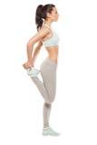 La donna di forma fisica sta allungando prima di pareggiare Forma fisica e stile di vita Fotografie Stock Libere da Diritti