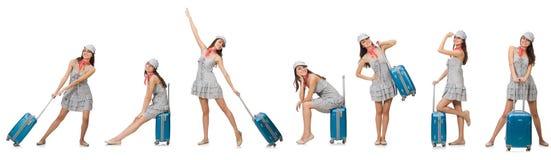 La donna di viaggio con la valigia isolata su bianco Fotografie Stock