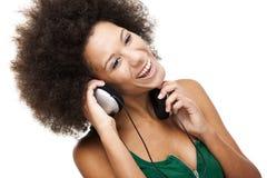 La donna felice ascolta musica Fotografia Stock