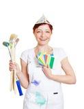 Donna in pittore complessivo con colore Immagini Stock