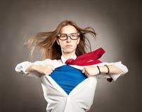 La donna gradisce un supereroe Fotografia Stock