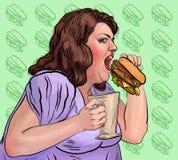 La donna grassa mangia un hamburger Fotografie Stock Libere da Diritti