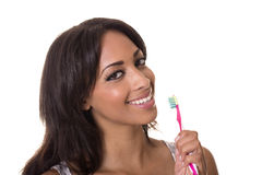 La donna graziosa tiene un toothbrush. Fotografie Stock