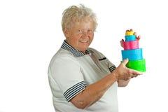 La donna maggiore con molti presenta Fotografia Stock Libera da Diritti