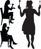 La donna mangia e beve la siluetta   Fotografia Stock