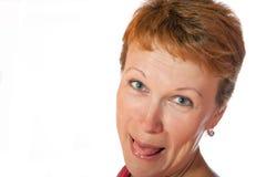 La donna mostra la linguetta Fotografia Stock Libera da Diritti