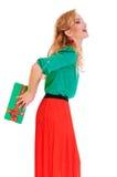 La donna nasconde il contenitore di regalo Fotografie Stock Libere da Diritti