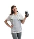 La donna offre una bottiglia di acqua fotografie stock