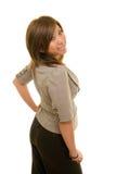 La donna osserva sopra la spalla Immagini Stock